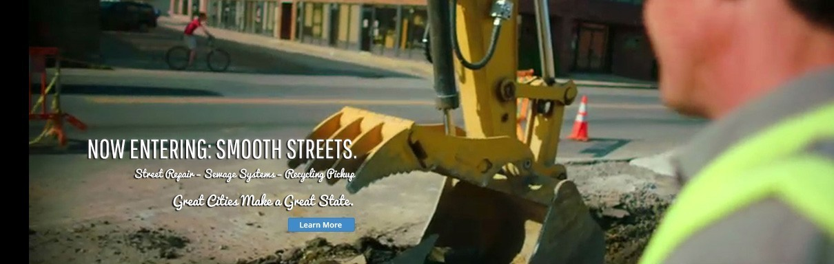Now Entering: Smooth Streets.  Street Repair - Sewage Systems - Recycling Pickup