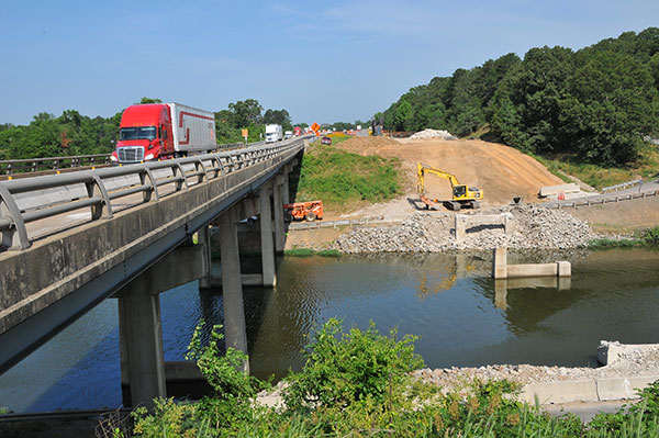Work associated with bridges, overpasses and large drainage structures under the roadway can significantly increase the cost of repairing an Interstate highway.