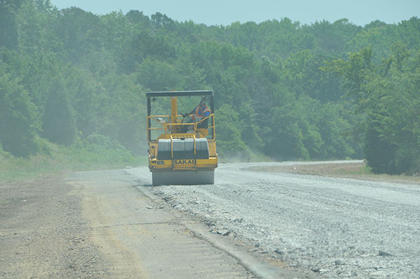 There are multiple ways to rehabilitate the Interstate highways in Arkansas. In the photo above the old, worn-out concrete was pulverized and is being compacted by a roller to form a good base for the new roadway pavement.